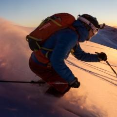 Golden skier in sunset
